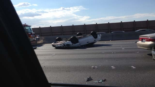 A rolled-over vehicle on Interstate 15 between Charleston and Sahara avenues on Wednesday, July 16. (Source: FOX5 Report It)