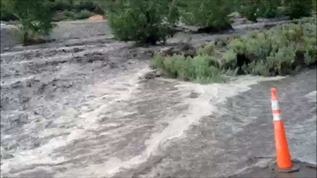 A FOX5 viewer sent in video of flood waters rushing through a wash near Mt. Charleston on July 28, 2014. (Nick Crawford/FOX5 Report It)