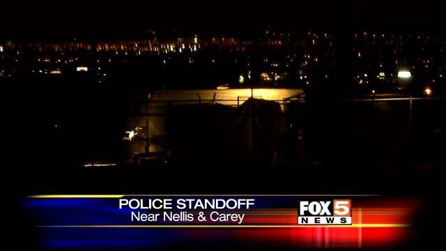 A mobile home in the distance is the scene of a police standoff on Friday, Aug. 1. (FOX5)