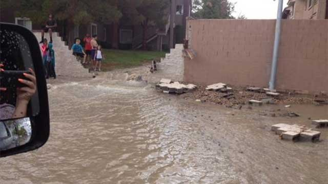 A FOX5 viewer sent in this picture of flood waters rushing through damaged wall in a Las Vegas neighborhood Aug. 4, 2014. (FOX5 Report It)
