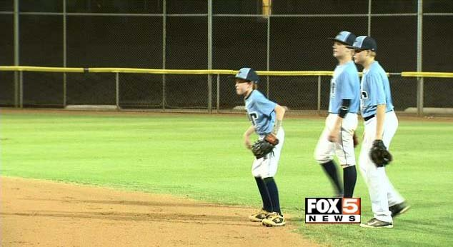 Members of the Mountain Ridge Little League team practice at a Las Vegas field on July 30, 2014. (File/FOX5)