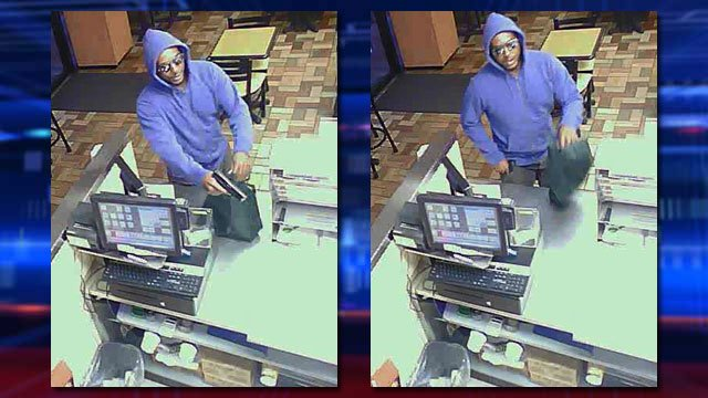 A man seen wearing a blue hooded sweatshirt robbed a business in the area of Charleston and Rainbow boulevards on July 22, 2014, according to police. (LVMPD)