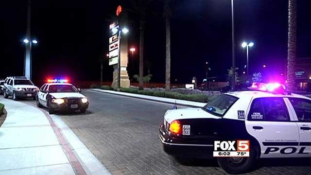 Police cruisers are parked outside a restaurant near the 215 Beltway and Flamingo Road after a shooting Aug. 16, 2014. (FOX5)