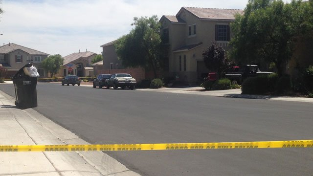 Police tape blocks off a section of Seabirds Place in North Las Vegas after a toddler was pulled from a backyard pool on Aug. 25, 2014. (Joe Lybarger/FOX5)