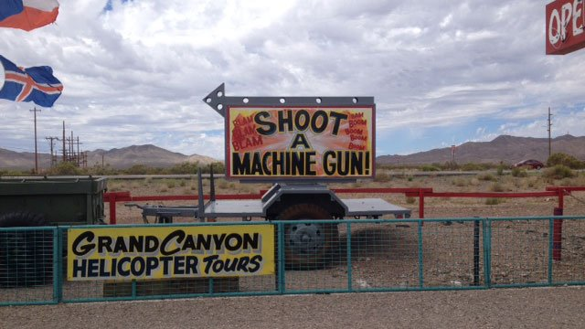 A sign at the Last Stop in White Hills, AZ, directs visitors to shooting range. A shooting instructor was shot there on Aug. 25, 2014, according to the Mohave Co. Sheriff's Office. (Tiffany Murphy/FOX5)