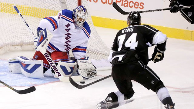 New York Rangers goalie Henrik Lundqvist (30) blocks a shot by Los Angeles Kings center Dwight King (74) in the third period of a preseason NHL hockey game, Friday, Sept. 27, 2013 in Las Vegas. The Kings won 4-1. (AP Photo/Julie Jacobson)