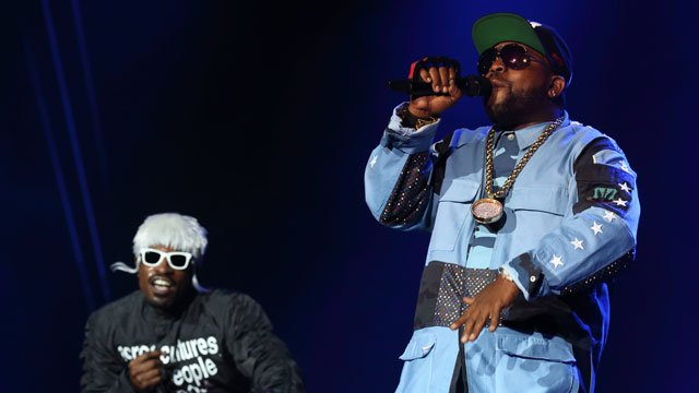 Andre 3000 (L) and Big Boi (R) of Outkast perform at Lollapalooza in Chicago's Grant Park on Saturday, Aug. 2, 2014. (Photo by Steve C. Mitchell/Invision/AP)