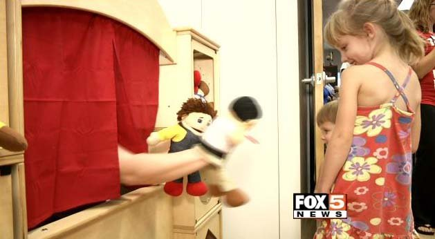Children are entertained by a puppet show in the play room at the Candlelighters Childhood Cancer Foundation facility on Monday, Sept. 15. (FOX5)