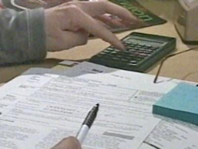 A person prepares tax documents in an undated photo. (File)