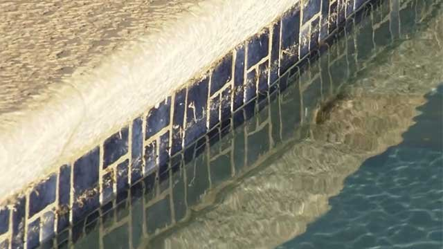 Water splashes against the tile-lined wall of a Las Vegas-area swimming pool. (File/FOX5)