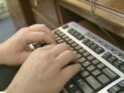 An employee works on a computer in an undated image. (File)
