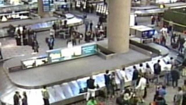 Travelers gather at  baggage claim in McCarran Airport. (File/FOX5)