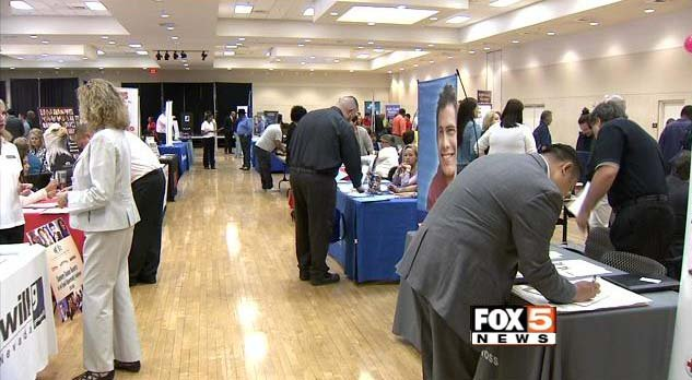 Job seekers attend a career fair (FOX5).