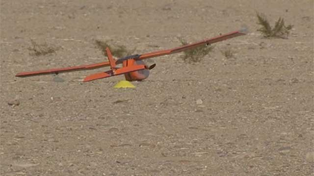 'Magpie' lays in the dirt after an unsuccessful test flight near Boulder City, NV, on Dec. 19, 2014. (Jason Valle/FOX5)