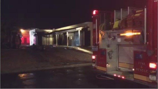 Fire in vacant apartment displaces family next door
