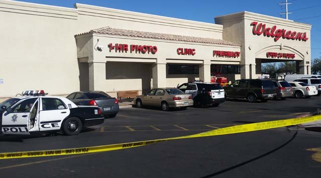 Crime tape and Las Vegas Metro vehicles at a Walgreens store where a deadly shooting occurred on Friday, Dec. 26. (Tiffany Murphy/FOX5)