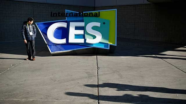 A man stands by an International CES sign at the Las Vegas Convention Center on Sunday, Jan. 4, 2015, in Las Vegas. The International CES convention starts Tuesday. (AP Photo/John Locher)