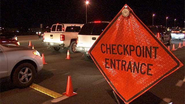A sign indicates the entrance of a DUI checkpoint near Blue Diamond Road and Decatur Boulevard. (FOX5)