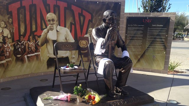 Towels and flowers were left at the statue dedicated to former UNLV men's basketball coach Jerry Tarkanian on Feb. 11, 2015. (Joe Lybarger/FOX5)