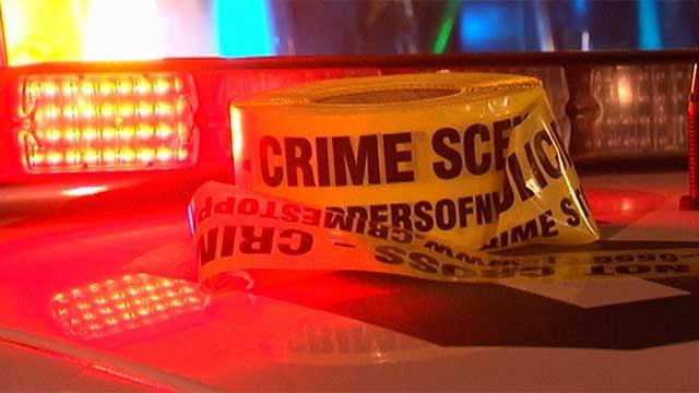 A roll of crime scene tape lays atop a Las Vegas Metro police cruiser. (File/FOX5)