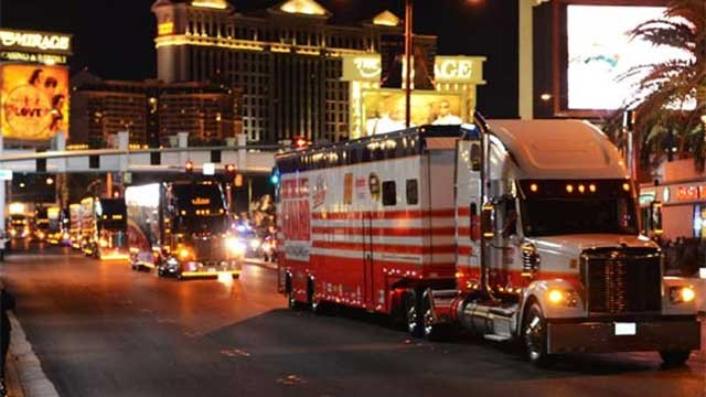 Semitrucks holding the vehicles for the NASCAR races at Las Vegas Motor Speedway paraded up Las Vegas Boulevard on March 5, 2014. (Source: Brian Jones/Las Vegas News Bureau)