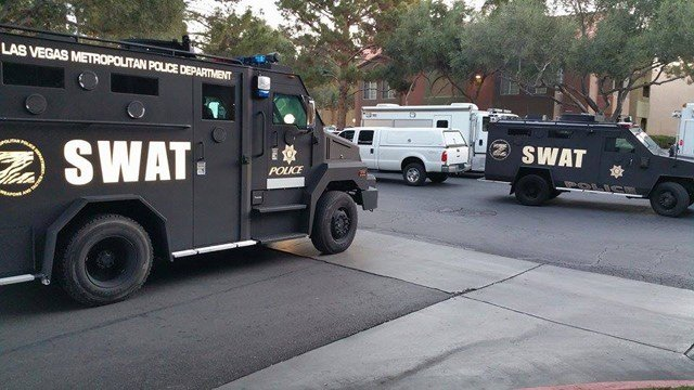 SWAT vehicles were parked inside an apartment complex near Craig Road and Las Vegas Boulevard North after an officer-involved shooting on Feb. 25, 2015. (Source: Leonetta Carvajal-Sells)
