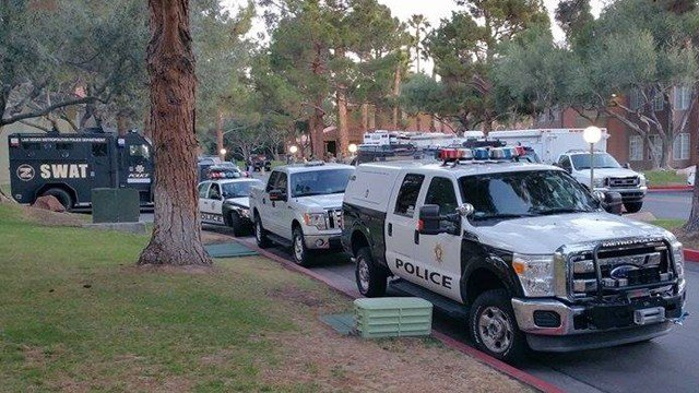 Las Vegas Metro police vehicles were parked inside Eagle Trace apartment complex after an officer-involved shooting on Feb. 25, 2015. (Source: Leonetta Carvajal-Sells)