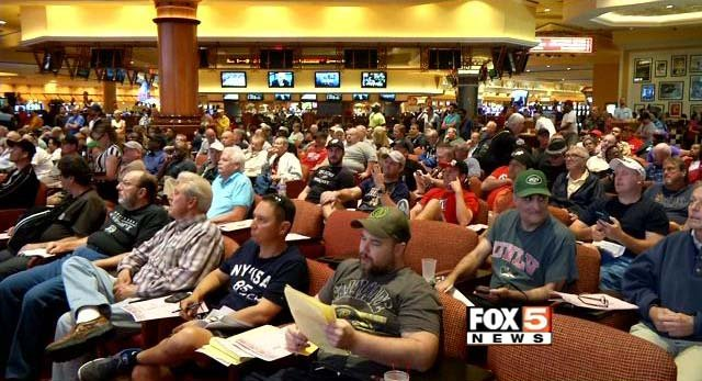 Bettors watch an NCAA tournament game at South Point Race and Sports Book on Thursday, March 19. (FOX5)