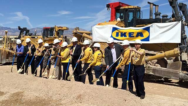 brian sandoval center and other officials place shovels into the ground