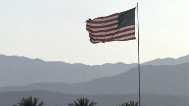 An American flag flaps in high winds atop a casino in Henderson. (File/FOX5)
