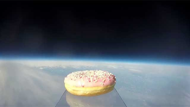A doughnut floats along the edge of space above Earth. (Source: Stratolys/YouTube)