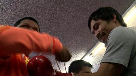 Boxing champ Manny Pacquaio worked out in the ring in front of media cameras in Los Angeles on April 15, 2015 before his mega-bout with Floyd Mayweather Jr. (Source: FOX)