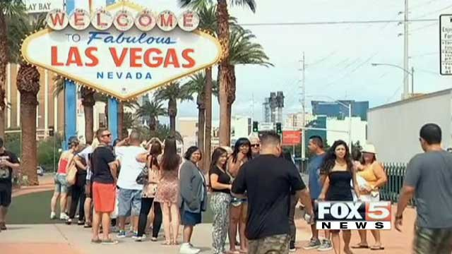 """Tourists line up to take their picture at the """"Welcome To Fabulous Las Vegas"""" sign on the Las Vegas Strip. (File/FOX5)"""