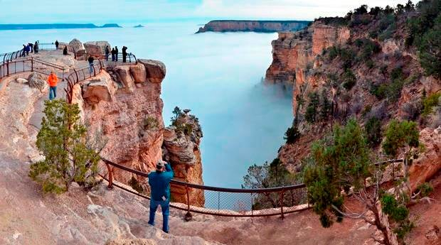 In this photo provided by the National Park Service, visitors to Mather Point on the South Rim of Grand Canyon National Park, view a rare weather phenomenon. (AP Photo/National Park Service, Michael Quinn)