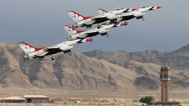 The United States Air Force Thunderbirds perform their legendary aerial acrobatics during Aviation Nation weekend at the crowded Nellis Air Force Base in Las Vegas, Nev. (AP Photo/Las Vegas News Bureau, Bob Brye)