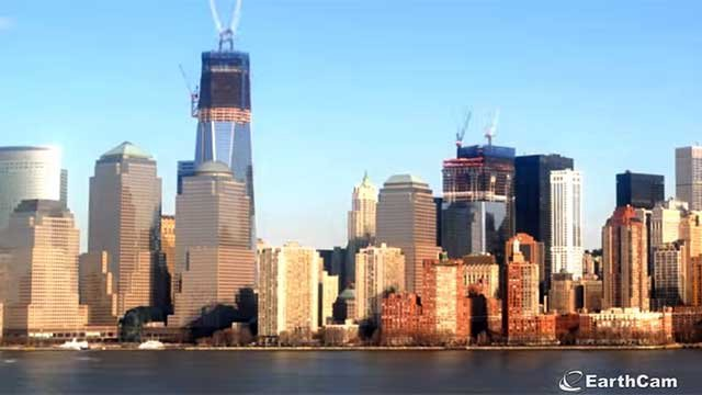 An under-construction One World Trade Center, left, is seen along the skyline of Manhattan. (Source: Earth Cam/YouTube)