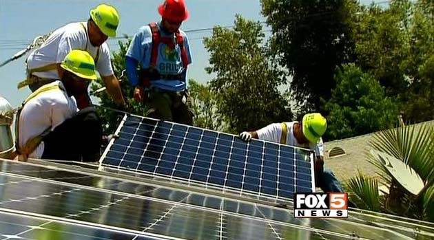 Workers install solar panels on the roof of a home in the Las Vegas Valley. (File/FOX5)