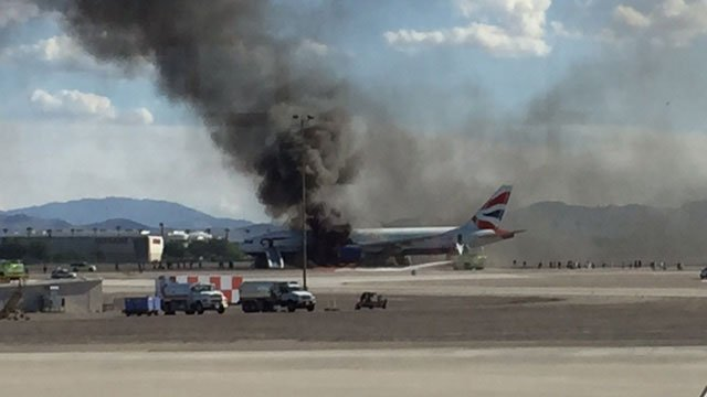 Smoke bellows from the British Airways flight that caught fire before takeoff at McCarran Airport on Sept. 8, 2015. (FOX5 ReportIt user Becky Barus)