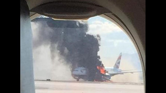 A passenger photo shows smoke from a fire apparently on a British Airways flight on the McCarran Airport tarmac on Sept. 8, 2015. (Source: Twitter/David L. Somers)