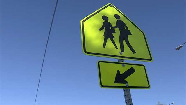 A sign indicates a crosswalk in a school zone near a Las Vegas-area school. (File/FOX5)