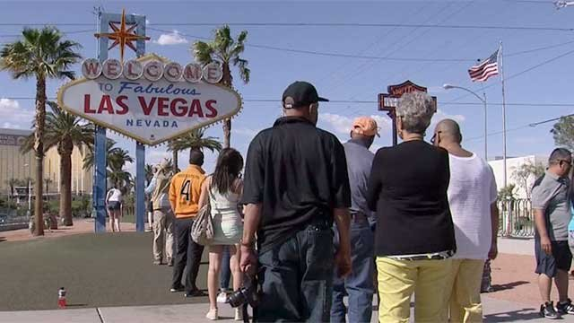 Tourist line up to take their picture at the iconic Las Vegas welcome sign. (File/FOX5)