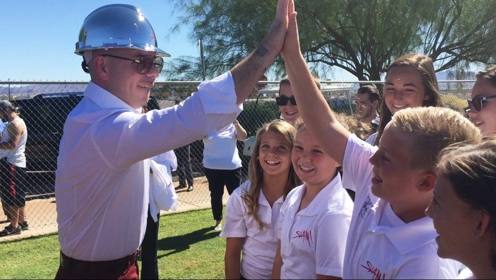 Pitbull high-fives a kid in attendance at the ground breaking of his SLAM! Nevada charter school in Henderson on Oct. 2, 2015. (Jon Archuleta/FOX5)