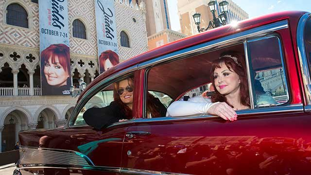 The Judds arrive at The Venetian Las Vegas in a classic cherry red 57 Chevy - Erik Kabik / erikkabik.com