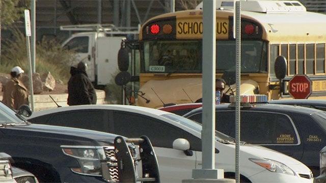 Several police vehicle are seen outside Mojave High School on Nov. 23, 2015 as students arrive. (Armando Navarro/FOX5)
