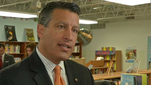 Nevada Gov. Brian Sandoval, R, talks to reporters during a visit to a Las Vegas Valley school. (File/FOX5)