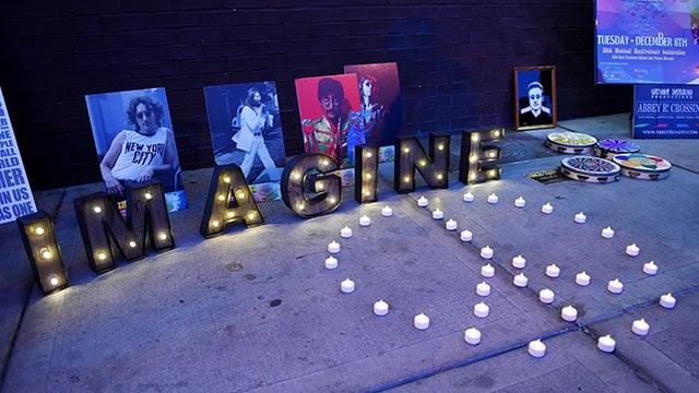 "Lights and photos of John Lennon are arraigned on the sidewalk at the ""Abbey Road Crossing"" on Fremont Street on the 35th anniversary of John Lennon's murder Tuesday,  Dec. 8, 2015. (Sam Morris/Las Vegas News Bureau)"