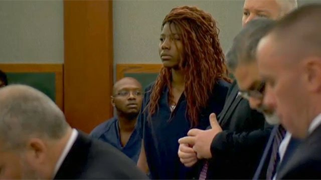 Lakeisha Holloway listens to proceedings during her first court appearance Dec. 23, 2015. (FOX5)