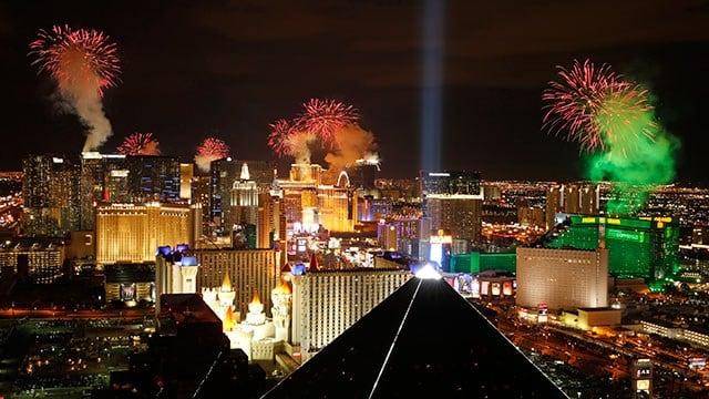 Fireworks explode above the Strip. (AP Photo/John Locher)