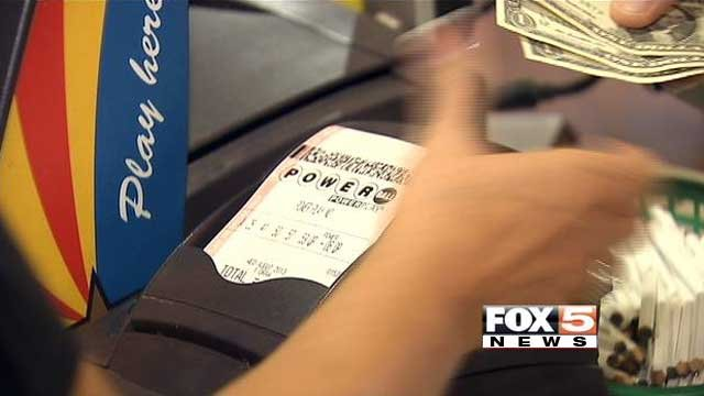 A cashier sells Powerball tickets at The Last Stop in White Hills, AZ. (File/FOX5)