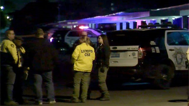 Crime scene investigators meet at an apartment complex where a homicide was reported on Luxor Way in northeast Las Vegas on Jan. 21, 2016. (Roger Bryner/FOX5)